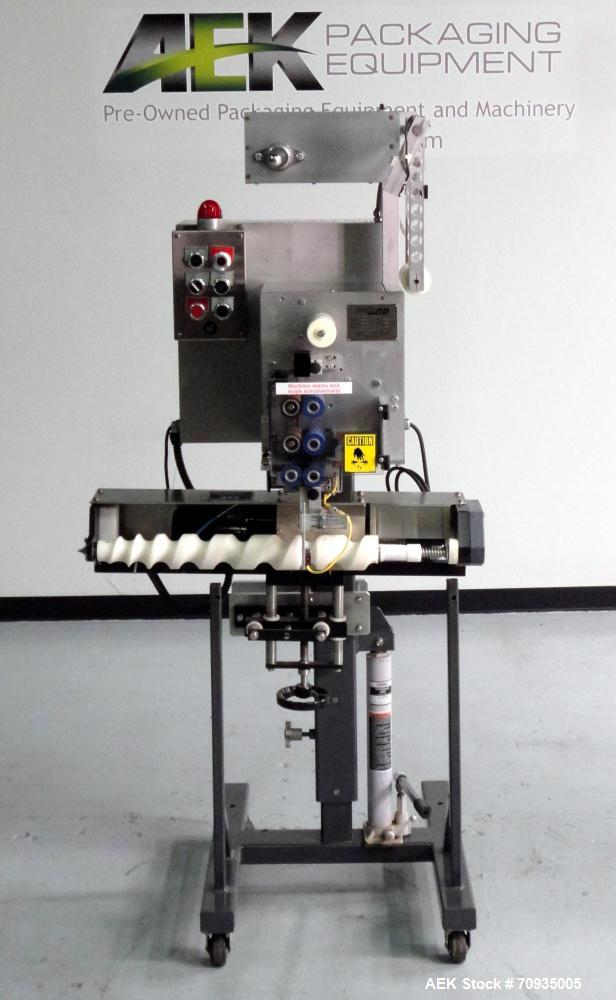 Used- Austin Gordon Model PD-202 Desiccant / Pouch Feeder. Machine is rated at speeds up to 245 ppm, depending on size of po...