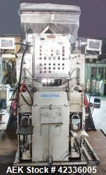 "Used- Arcopak Dual Spout Valve Bag Packer, Type C-300. 2"" Stainless steel spouts, independent 5 hp, 575 volt motors, Weightr..."