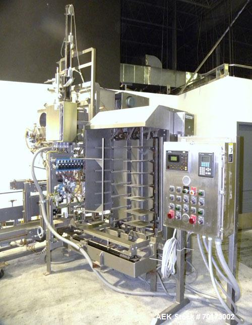 Used- Taylor Products TOMP Open Mouth Bag Hanger with APO Bulk Bag Filling Line. Machine is capable of speeds up to 15 bags ...