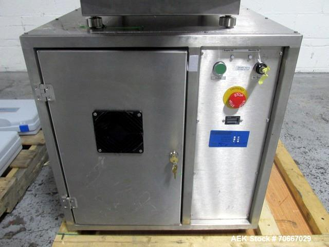 Used- Capsugel Xcelodose Capsule Filler, Model XD600. With cabinet and 00, 0, 1, 2, 3, 4 change parts, serial# 600-1-040.