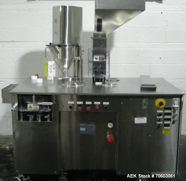 Used- Capsugel Ultra 8 II Capsule Filler. Stainless steel construction, feed hopper with chute, powder fill station with agi...