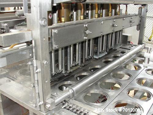 Used-AutoProd 6 Lane Cup Filler and Induction Sealer. Stainless steel contact parts. Model FP 1 x 6. Filler has cup dispense...