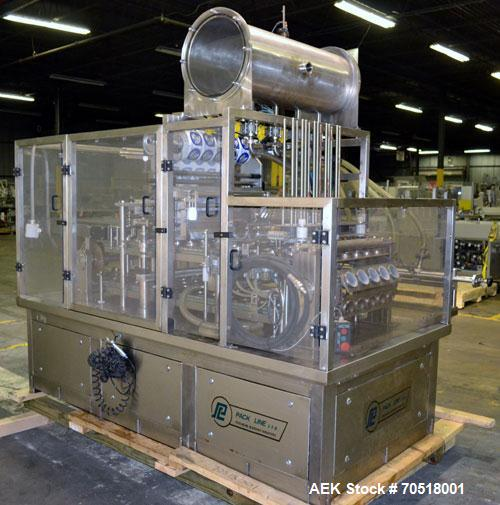 Used- Pack Line PXM-5 Cup Filling and Sealing Machine. Unit is a five lane system with speeds rated from 30 to 50 cycles per...