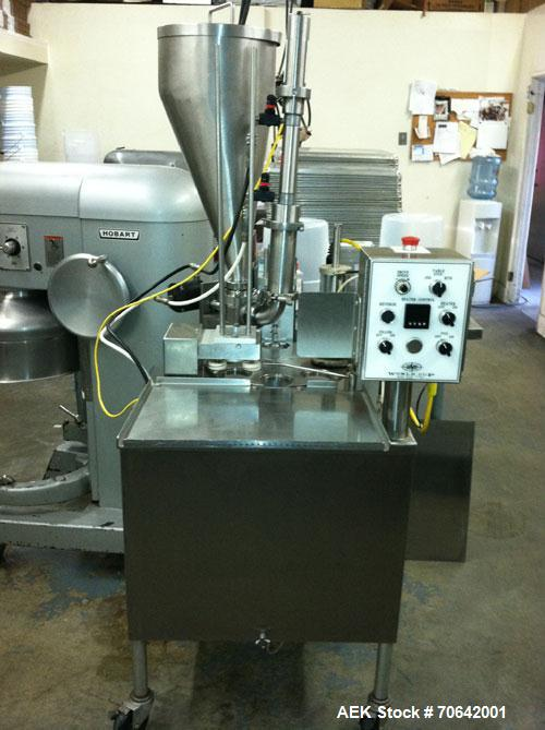 Used-World Cup Rotary Cup Filler and Heat Sealer, Model 8-12, capable of speeds up to 45 containers per minute.Container siz...