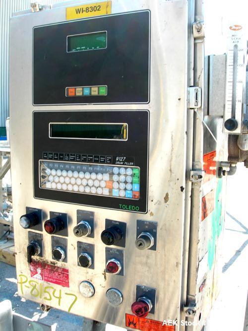 "Used-Mettler Toledo XP drum filling system consisting of: (1) Mettler model 9127 drum filler, approximate 2"" diameter x 36"" ..."