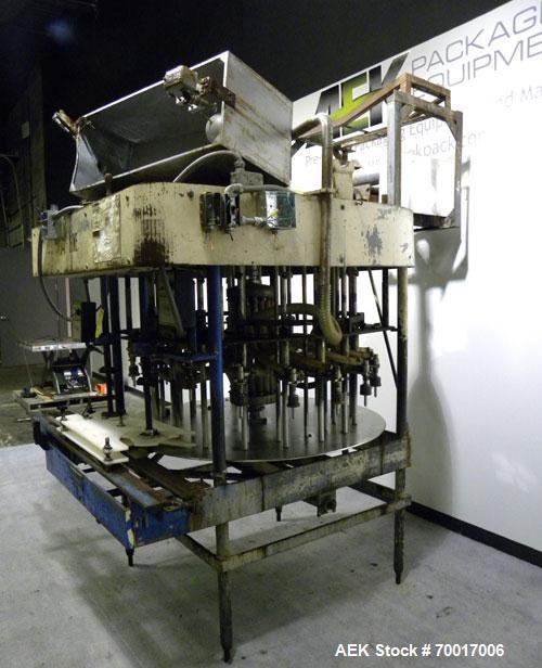 "Used- Biner-Ellison 18 Head Rotary Gravity/Pressure Filler, Model F-52-TDP-18. Has 1/2"" diameter 316 stainless steel nozzles..."
