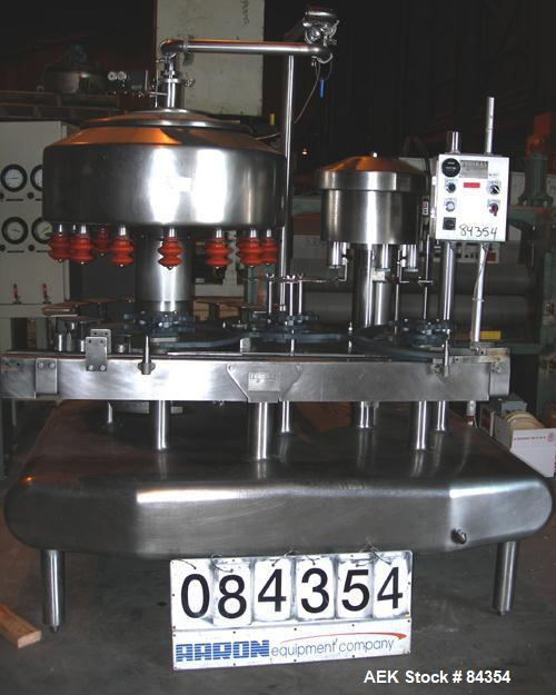 """Used- Federal Rotary Gravity Filler, Model GWS3/155R1092, 304 Stainless Steel. (15) 1"""" diameter nozzles on approximate 7-1/2..."""