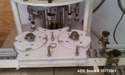 """Used- Horix Rotary Overflow Filler, 8 head. Nozzles are 7/16"""", 5-7/16"""" center to center; max diameter bottle 5-1/2"""". Include..."""