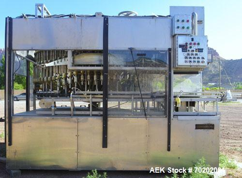 Used-Laub 72 Bottle Filler Gravity Vacuum Filler, Model F10-GTV-72. Rotary 72 valve liquid filler with infeed screw to star ...