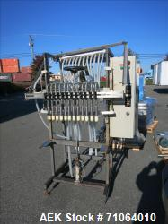 Used-Custom Made 12 Head Inline Gravity Filler, with stainless steel tank and control unit.  On a stainless steel frame.