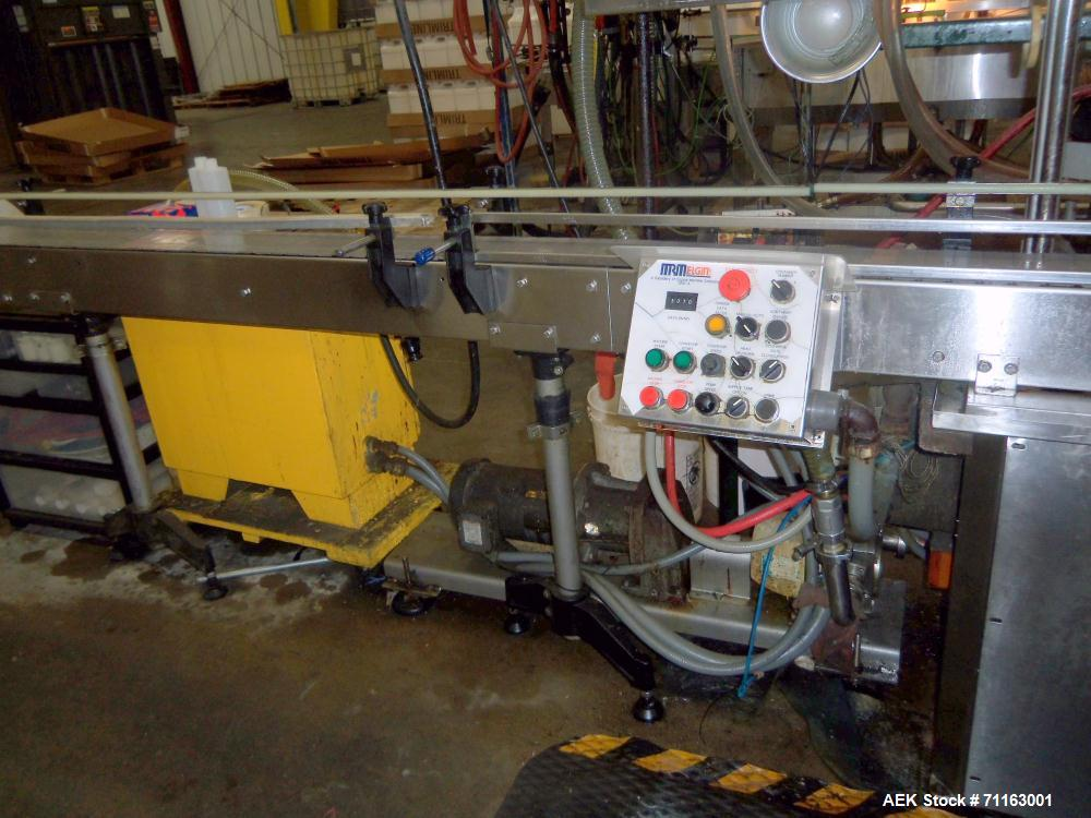 Used-MRM Elgin 8 Head In Line Semi Auto Pressure Gravity Filler, Model GRC-A, Serial # GRCA08176.  Includes conveyor.
