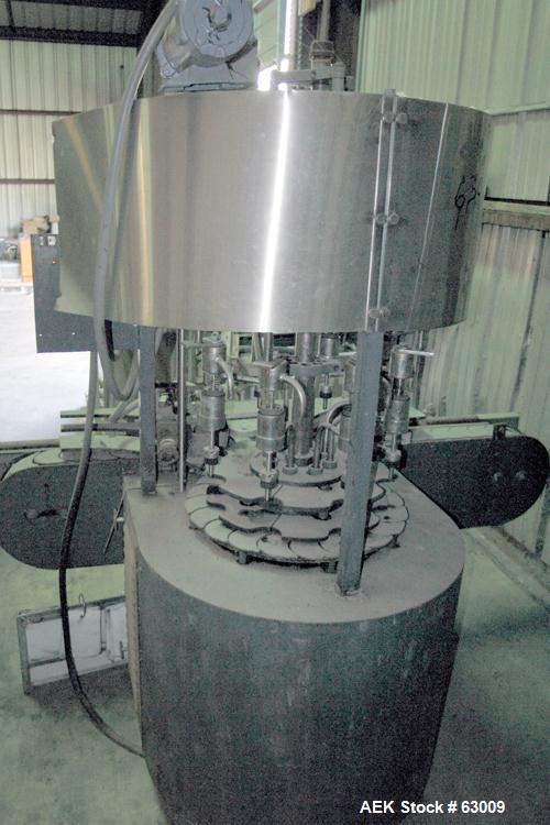 """Used- U.S. Bottlers 8 Head Rotary Gravity Fillter. Has 1/2"""" diameter nozzles which are stainless steel. Nozzles are set on 7..."""
