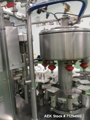 Used- Federal Two component filler capper. Equipped with (8) filling heads and (4) capping heads. Full change parts for 33.8...