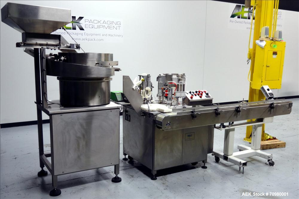 Used- M&O Perry P-3000 II Monoblock Unscrambler, Filler, Plugger, and Screw Capper. Capable of speeds up to 35 bottles per m...