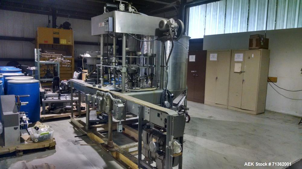 "Used- 12 Head Elgin Rotary Filler, Model MRM. Vacuum operated. 7.25"" nozzle diameter, 12' converyor belt, explosion Proof. E..."