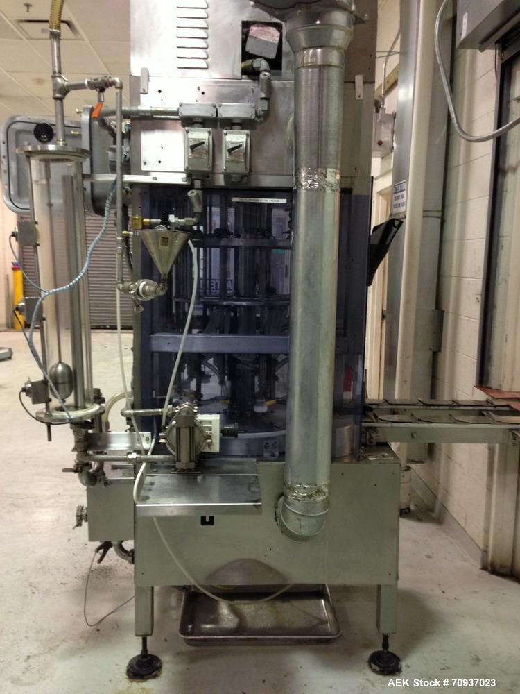Used- JG Machine 12 Head Rotary Vacuum Pocket Filler. Production rates up to 80 cpm(depending on size and material filled). ...