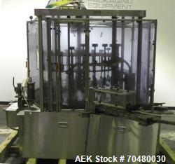 Used- MRM Elgin (Cozzoli) 24-Head Rotary Vacuum Overflow Filler