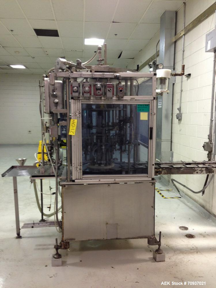Used-RJM 12 Head Rotary Vacuum Filler, explosion proof, vacuum jar, stainless steel and lexan guards, stainless steel supply...