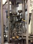 Used-MRM 8 Head Rotary Vacuum Filler, speeds up to 100 bottles per minute maximum, vacuum jar, explosion proof design, stain...