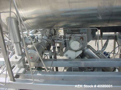 Used-Raque Piston Filler, stainless steel. 100 gallon aseptic tank with agitator, model PF-2.5-1A. Manufactured in 1988.