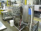 Used- Filamatic 4 head inline piston filler. Has pin indexing system, bottom up fill, 240cc pistons, 10'L conveyor. Mounted ...
