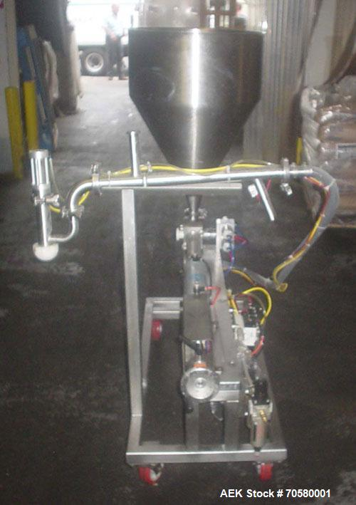 Used-Volumetrics Tech Piston Filler. 316 Stainless steel contacts, stainless steel base, 15 gallon hopper, rotary actuator v...