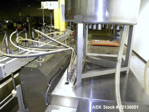 Used- Kalish Kalishtronic Model KT12 Positive Displacement Filler. Currentlyt set up with 8 pumps and filling nozzles. Has n...