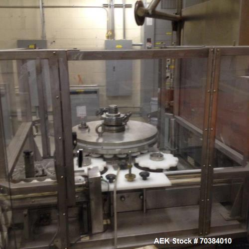 Used- MRM Versafil 20 head Positive Displacement Rotary Filler. Right to left with starwheel infeed and discharge. 20 stainl...