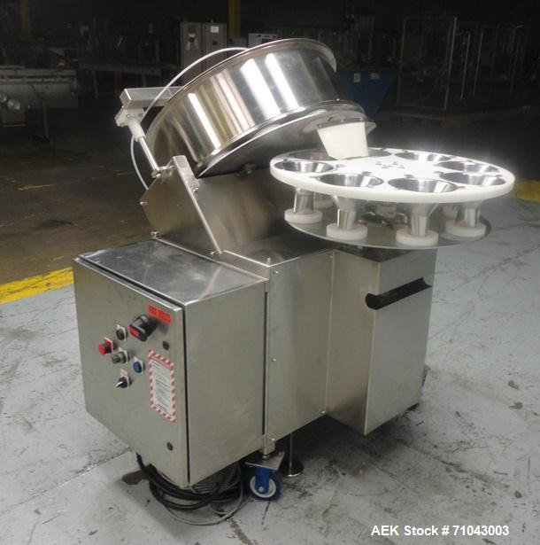 Used- FEMC Model 1134 Angular Dial Volumetric Filler. Machine is capable of speeds up to 160 containers per minute. Hopper c...
