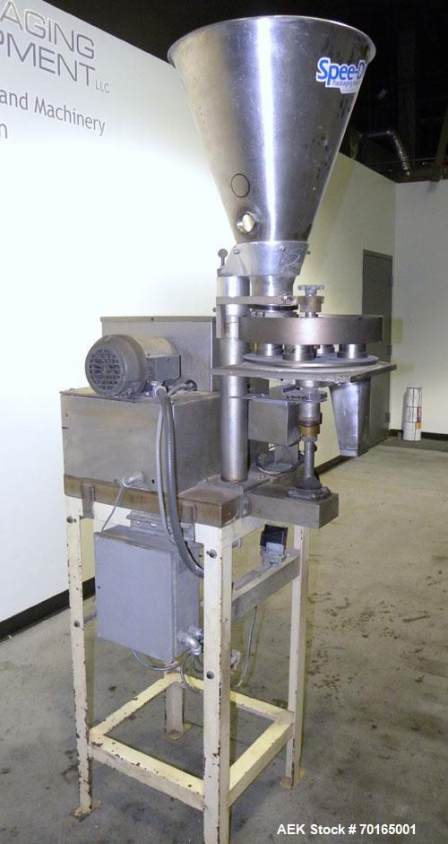 """Used- Spee-Dee 4-Pocket Volumetric Cup Filler. Has approximately (4) 2"""" diameter cups with stainless steel supply hopper mou..."""