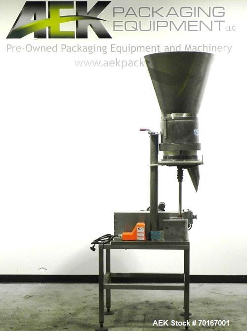 Used- Spee-Dee BR-344 Volumetric Cup Filler. Capable of speeds up to 80 fills per minute. Has a 1.5 cubic foot stainless ste...