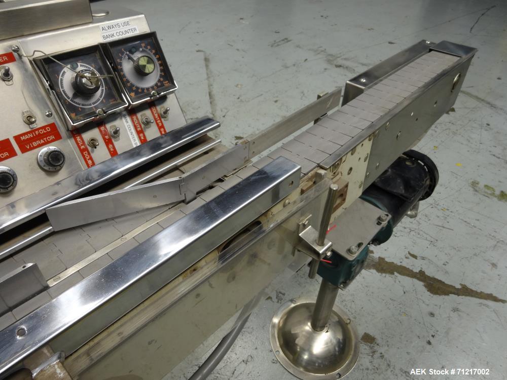 Used- Merrill Dual Lane Slat Counter, Model 72-39 AD.