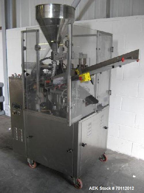 Used-Comadis C-125 Plastic and Metal Tube Filler, rotary valve piston tube filler