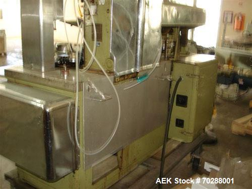 "Used- Arenco GAN Metal tuber filler capable of speeds from 25 to 150 TPM. Twin piston unit will handle tubes up to 1-3/4 "" D..."