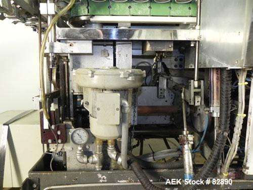 Used- Arenco Model AM2000 Twin Piston Laminate Tube Filler. Currently equipped with high frequency sealer. Tubes are fed aut...