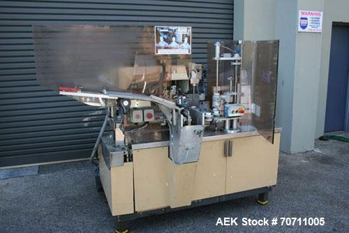 Used-Arenco Plastic Tube Filler. Suitable for plastic tubes, hot air seal, 22 pocket rotary system, auto tube loader, full c...