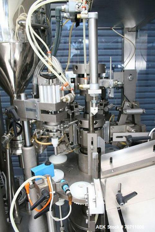 Used-Axiomatic Model Optima 700 Axomatic Tube Filler. 7 Station, water cooled hot jaws, hopper with agitator, maximum speed ...