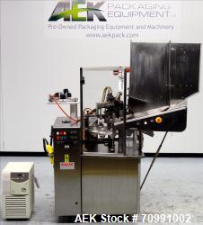 Used- Kalix Model KX-600E automatic hot air plastic tube filler