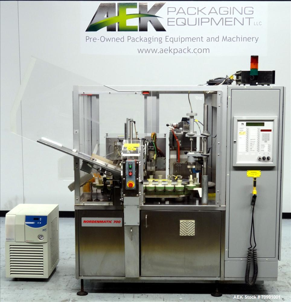 Used- Norden Model NM 700 HA Hot Air Plastic Tube Filler. Capable of speeds up to 70 tubes per minute. General Fill volume r...