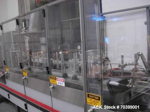 Used-Used: Bartelt IM7-14 horizontal form fill & seal machine. Has single head auger filler on it. Has AB PLS 5000 electro c...
