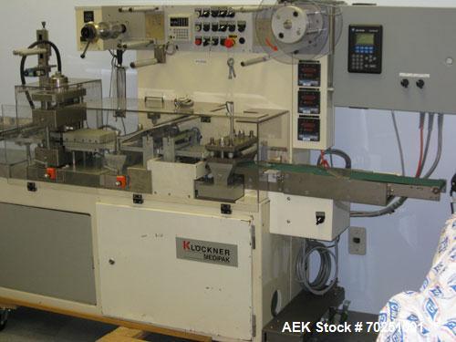 Used-Klockner Medipak Model CP2 Blisterpacking Machine. Has manual load table, perf station, scrap rewind and Allen Bradley ...