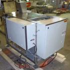 Used- Jaguar Model 3000 Automatic Wicketed Bag Sealer. Capable of speeds up to 40 bags per minute. Handles gusseeted, ziploc...
