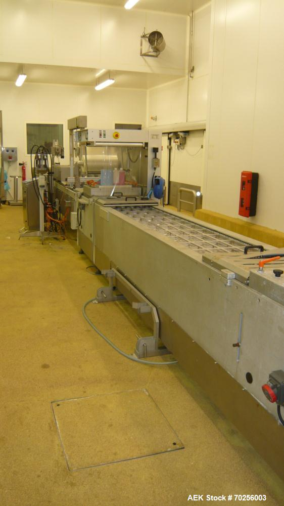 """Used- Multivac Thermoforming Line. Model R7000. Film width - 20.6"""" (522 mm). Fully refurbished 2006."""