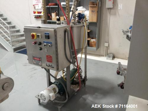 Used- Cryovac 2000B Vertical Form Fill Seal Machine for Liquids. Capable of speeds up to 30 bags per pouch per minute. Has a...