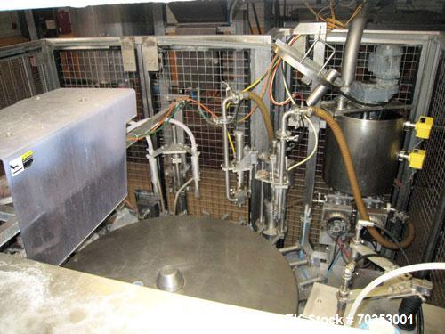 Used-Toyo Jidoki TT9CW rotary premade pouch filler capable of speeds up to 80 pouches per minute. Machine opens, fills, inje...