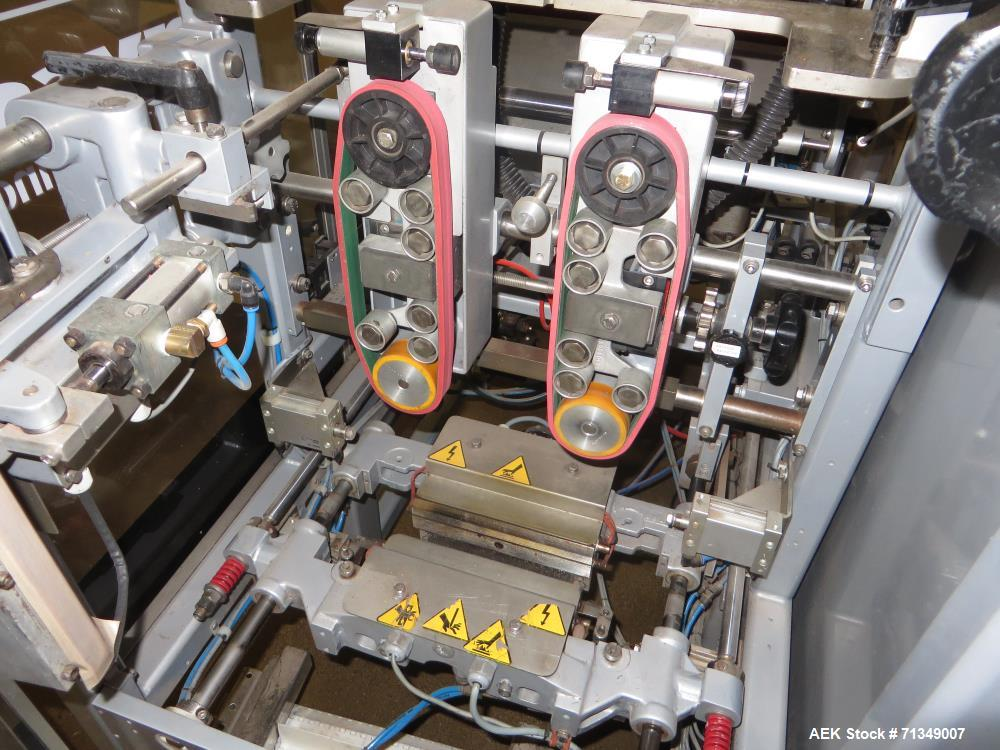 Used-Hayssen Model 300E Vertical form fill and seal packaging system. Complete line includes with Ishida 16 head dimpled/emb...