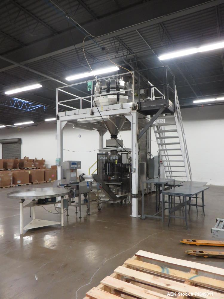 Used-Matrix Packaging  Model  Elete DS13  Vertical form fill and seal packaging system. Complete line includes Yamato Adw-71...