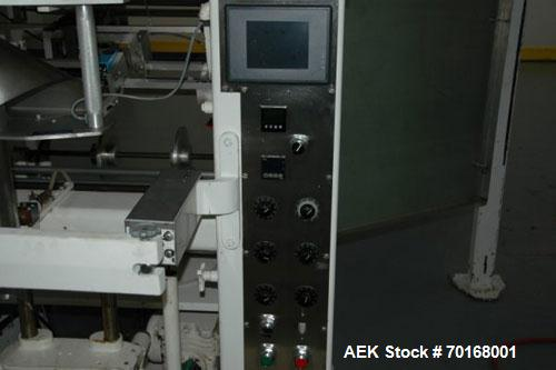 Used-Triangle L6C Vertical Form Fill Seal Machine. Capable of speeds up to 45 bags per minute. Omron PLC controls with Allen...