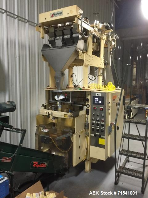 Used-Triangle Model S5C Vertical form fill and seal bagger system.  Complete line includes; Weight scale (4 scales) Model A4...