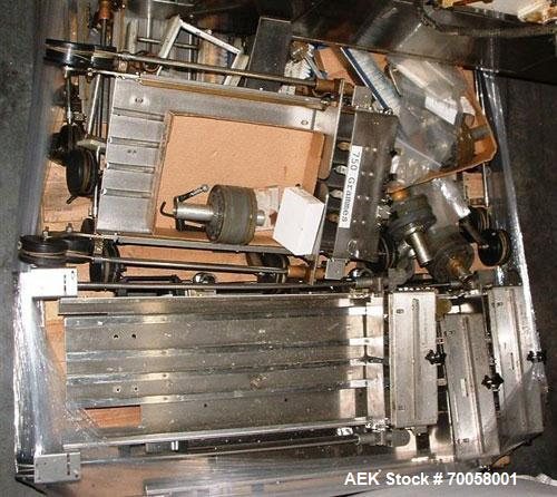 Used-Krones Rondella 88 Wraparound Hot Glue Labeler capable of speeds up to 400 bpm. Glue is applied to the leading and trai...